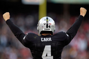 OAKLAND, CA - DECEMBER 07: Derek Carr #4 of the Oakland Raiders celebrates in the fourth quarter against the San Francisco 49ers at O.co Coliseum on December 7, 2014 in Oakland, California. (Photo by Brian Bahr/Getty Images)