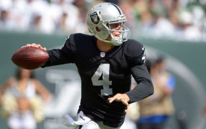Sep 7, 2014; East Rutherford, NJ, USA; Oakland Raiders quarterback Derek Carr (4) throws a pass against the New York Jets at MetLife Stadium. Mandatory Credit: Kirby Lee-USA TODAY Sports