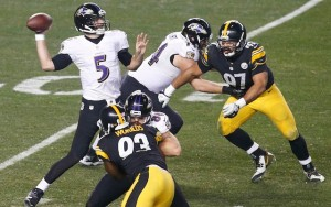 Jan 3, 2015; Pittsburgh, PA, USA; Baltimore Ravens quarterback Joe Flacco (5) throws the ball in front of Pittsburgh Steelers defensive end Cameron Heyward (97) during the second quarter in the 2014 AFC Wild Card playoff football game at Heinz Field. Mandatory Credit: Charles LeClaire-USA TODAY Sports