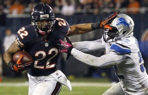 Chicago Bears running back Matt Forte (22) stiff-arms Detroit Lions linebacker Justin Durant (52) in the first half of an NFL football game in Chicago, Monday, Oct. 22, 2012. (AP Photo/Charles Rex Arbogast)