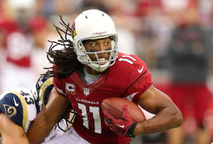 GLENDALE, AZ - NOVEMBER 25: wide receiver Larry Fitzgerald #11 of the Arizona Cardinals runs with the football after a reception against the St. Louis Rams during the NFL game at the University of Phoenix Stadium on November 25, 2012 in Glendale, Arizona. The Rams defeated the Cardinals 31-17. (Photo by Christian Petersen/Getty Images)