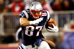 FOXBORO, MA - NOVEMBER 18: Rob Gronkowski #87 of the New England Patriots attempts to run through a tackle after catching a pass against the Indianapolis Colts during the game on November 18, 2012 at Gillette Stadium in Foxboro, Massachusetts. (Photo by Jared Wickerham/Getty Images)