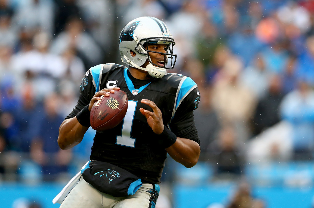 CHARLOTTE, NC - DECEMBER 22: Cam Newton #1 of the Carolina Panthers drops back to pass during their game against the New Orleans Saints at Bank of America Stadium on December 22, 2013 in Charlotte, North Carolina. (Photo by Streeter Lecka/Getty Images)